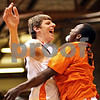 Beck Diefenbach  -  bdiefenbach@daily-chronicle.com<br /> <br /> DeKalb's Jordan Threloff (left) is welcomed to the court by Anthony Baker before the start of the game against Batavia at DeKalb High School in DeKalb, Ill., on Tuesday Jan. 26, 2010. DeKalb defeated Batavia 68 to 65 in overtime.