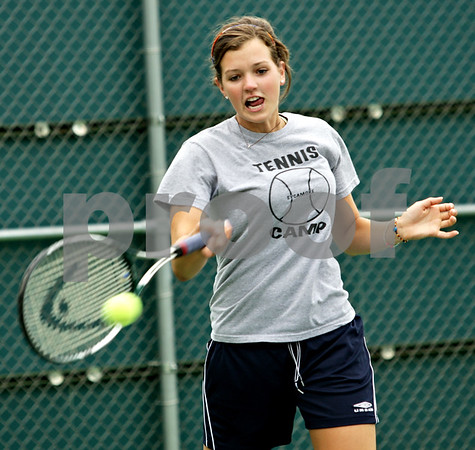 Beck Diefenbach - bdiefenbach@daily-chronicle.com<br /> <br /> Sycamore's Emily Eggers returns the ball during doubles practice at Sycamore High School in Sycamore, Ill., on Tuesday Aug. 17, 2010.