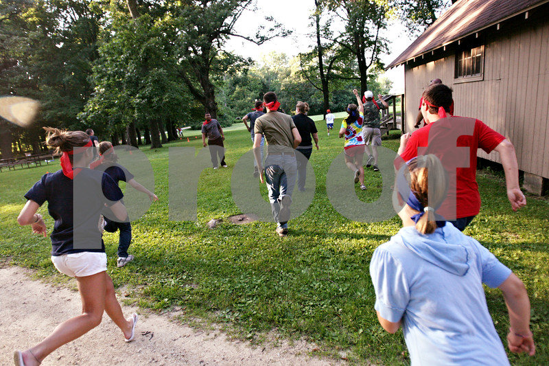 Beck Diefenbach  -  bdiefenbach@daily-chronicle.com<br /> <br /> Members of the blue and red team attack the green team during a capture the flag tournament at Chief Shabbona Forest Preserve for youth members of the Village Bible Church on Wednesday June 30, 2010.