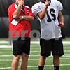 Rob Winner – rwinner@daily-chronicle.com<br /> <br /> NIU coach Jerry Kill (left) talks with punter Tyler Anderson during practice on Friday August 13, 2010 at Huskie Stadium in DeKalb, Ill.