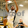 Rob Winner – rwinner@daily-chronicle.com<br /> Sycamore's Lake Kwaza puts up two with Kaneland's Tesa Alderman trailing during the first quarter of their game on Friday night in Sycamore. Sycamore defeated Kaneland, 62-52.