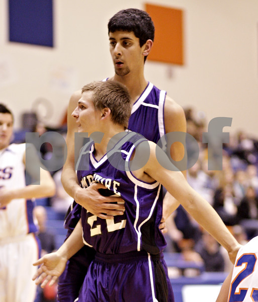 Beck Diefenbach  -  bdiefenbach@daily-chronicle.com<br /> <br /> Hampshire's Sarwan Khan (45, top) holds onto Mike Kuefner (22) as he reacts to a foul call on him during the third quarter of the game against Genoa-Kingston at Genoa-Kingston High School in Genoa, Ill., on Monday Jan. 11, 2009. Hampshire defeated G-K 57 to 52.