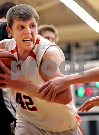 Beck Diefenbach - bdiefenbach@daily-chronicle.com<br /> <br /> DeKalb's Jordan Threloff grabs a rbeound during the second half of the IHSA Class 3A Regional championship game against Kaneland at Kaneland High School in Maple Park, Ill., on Friday March 3, 2010.