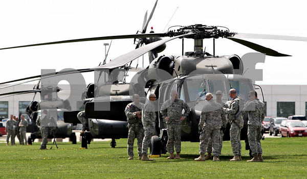 Rob Winner – rwinner@daily-chronicle.com<br /> <br /> Servicemen of the Illinois National Guard gather outside three Black Hawk helicopters after they landed in a lacrosse field just north of the Convocation Center in DeKalb, Ill. on Friday April 16, 2010.