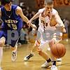 Beck Diefenbach  -  bdiefenbach@daily-chronicle.com<br /> <br /> DeKalb's Pat Rourke (25, right) nearly loses the ball during the third quarter of the game against Geneva at DeKalb High School, in DeKalb, Ill., on Friday Jan. 5, 2010. DeKalb defeated Geneva 55 to 52.