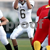 Rob Winner - rwinner@daily-chronicle.com<br /> <br /> Quarterback Ryan Bartels grabs a high snap during the first quarter of their game against North Lawndale at Lane Stadium in Chicago, Ill. on Saturday August 28, 2010.