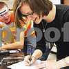 Rob Winner – rwinner@daily-chronicle.com<br /> <br /> Elise Holbrook (right), of DeKalb, writes down her observations during a chemistry lab while working with her cousin Connor Bolander, of Sycamore, at Kishwaukee College in Malta, Ill. on Tuesday June 8, 2010.