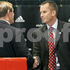 Rob Winner – rwinner@daily-chronicle.com<br /> <br /> Athletic director Jeff Compher (left) shakes hands with Dave Doeren during a press conference at the Convocation Center in DeKalb on Monday afternoon. Doeren was named the new head coach of the Northern Illinois University Huskies football team.