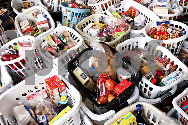 Rob Winner – rwinner@daily-chronicle.com<br /> <br /> Staff and volunteers prepared 770 Thanksgiving food baskets at the Salvation Army in DeKalb on Monday morning. The baskets will be distributed today to families in need.<br /> <br /> **today meaning Tuesday