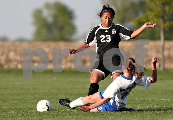 Rob Winner – rwinner@daily-chronicle.com<br /> <br /> Hinckley-Big Rock's Alyssa Baunach (bottom) kicks a ball away from Kaneland's Thalia Garcia during the first half of their game in Hinckley, Ill. on Wednesday April 28, 2010.