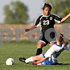 Rob Winner – rwinner@daily-chronicle.com<br /> <br /> Hinckley-Big Rock's Alyssa Baunach (bottom) kicks a ball away from Kaneland's Thalia Garcia during the first half of their game in Hinckley, Ill. on Wednesday April 28, 2010.