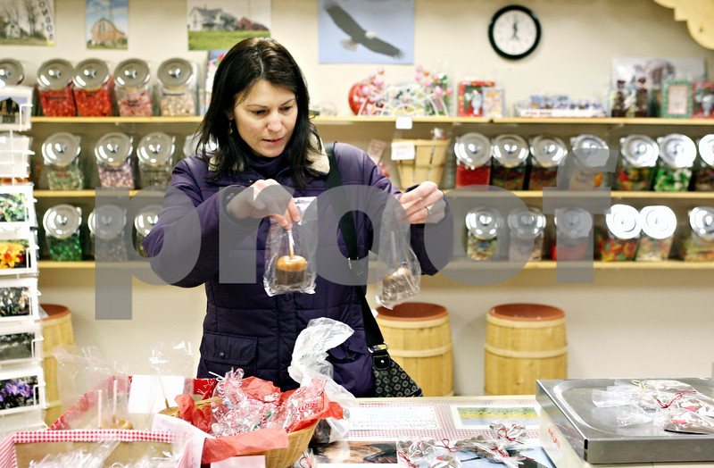 Rob Winner – rwinner@daily-chronicle.com<br /> <br /> Sycamore resident Pam Nelson picks out some last minute holiday gifts at The Confectionary on Tuesday night in Sycamore.