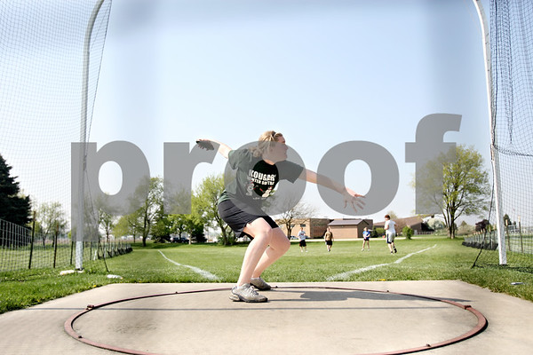 Rob Winner – rwinner@daily-chronicle.com<br /> <br /> Jessica Pluhm practices throwing the discus during practice in Sycamore, Ill. on Thursday April 22, 2010.
