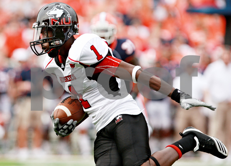 Rob Winner – rwinner@daily-chronicle.com<br /> <br /> Northern Illinois wide receiver Martel Moore runs for some yards after a reception during the first half in Champaign, Ill.  on Saturday September 18, 2010.