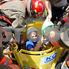 Rob Winner – rwinner@daily-chronicle.com<br /> <br /> Bronwyn Burgweger, of Kirkland, volunteered to be rescued from a grain bin by Malta firefighters during a simulation by Stateline Fire Rescue at the DeKalb County Farm Safety Camp in Malta, Ill. on Wednesday June 23, 2010.
