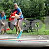 Beck Diefenbach  -  bdiefenbach@daily-chronicle.com<br /> <br /> Camp staff members Brooke Buchmann (far left) and Krista Horn (right) helps Connie Kaesmeyer get into a canoe at Walcamp Outdoor Ministries in Kingston, Ill., on Monday July 12, 2010. The camp also serves individuals with special needs.