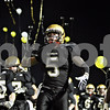 Rob Winner – rwinner@daily-chronicle.com<br /> <br /> Sycamore's Eric Ray and his teammates run onto the field before the start of their Class 5A first-round playoff game in Sycamore, Ill. on Saturday October 30, 2010. Sycamore went on to defeat Lakes, 36-3.