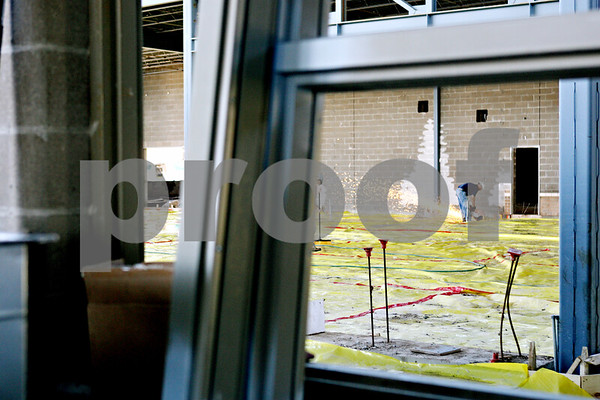 Rob Winner – rwinner@daily-chronicle.com<br /> <br /> A construction worker works inside the cafeteria at the new DeKalb High School in DeKalb, Ill. on Wednesday June 9, 2010.