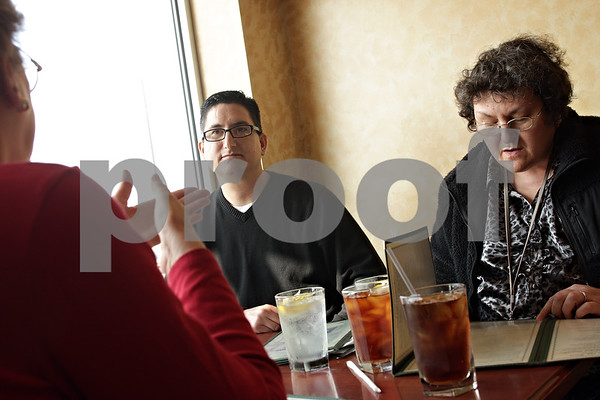 Beck Diefenbach  -  bdiefenbach@daily-chronicle.com<br /> <br /> Richard Salazar (center) talk with his fiance Marlene XXX (right) and her mother XXX (far left) about their wedding plans over lunch at Egg Haven in DeKalb, Ill., on  Wednesday March 10, 2010. Salazar and XXX are engaged to get married in XXX.