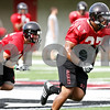 Rob Winner – rwinner@daily-chronicle.com<br /> <br /> Alex Kube runs down field with his teammates as NIU focused on special teams play on Friday August 13, 2010 at Huskie Stadium in DeKalb, Ill.