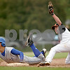 Beck Diefenbach  -  bdiefenbach@daily-chronicle.com<br /> <br /> Geneva's Matt Williams (11, left) is tagged out at third base by DeKalb's Ben Dallesasse (15, right) during the fourth inning of the game at DeKalb High School in DeKalb, Ill., on Wednesday May 12, 2010. DeKalb defeated Geneva 4 to 3.