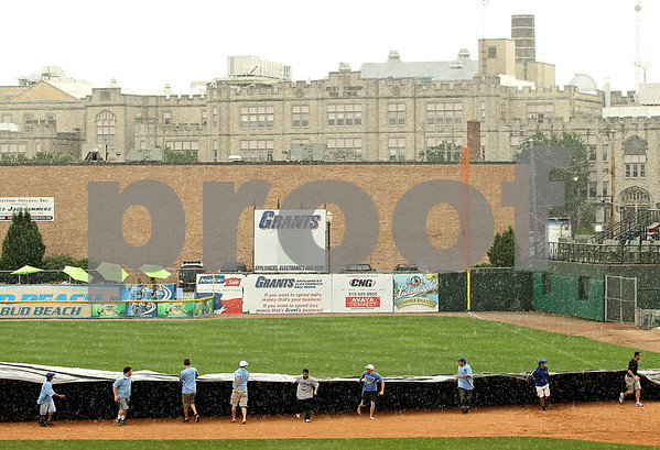 Beck Diefenbach  -  bdiefenbach@daily-chronicle.com<br /> <br /> The field is covered to protect the diamond during a rain storm causing a rain delay during the third inning of the IHSA Class 3A State Semifinal Game in Joliet, Ill., on Friday June 11, 2010.