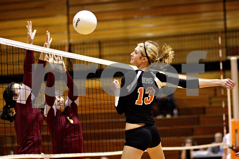 Beck Diefenbach – bdiefenbach@daily-chronicle.com<br /> <br /> DeKalb's Courtney Bemis (13) attempts to return the ball during the first game against Morris at DeKalb High School in DeKalb, Ill., on Tuesday Sept. 28, 2010.