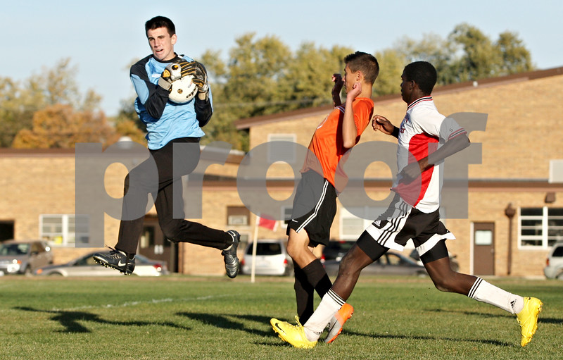 Rob Winner – rwinner@daily-chronicle.com<br /> <br /> Byron goalkeeper Riley Egan grabs an Indian Creek shot during the second half of the regional quarterfinal in Waterman, Ill. on Wednesday October 13, 2010. Indian Creek went on to defeat Byron, 2-1, in double overtime.