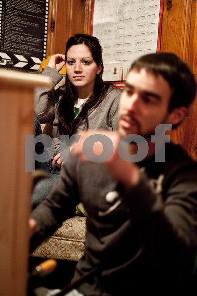 Beck Diefenbach – bdiefenbach@daily-chornicle.com<br /> <br /> Holly Swaim, Kevin's girlfriend, watches as he puts the finishing touches on the dresser the day before he plans on leaving on Jan 15, 2009.