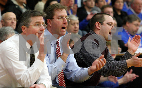 Rob Winner – rwinner@daily-chronicle.com<br /> Hinckley-Big Rock coaches Jerry Tokars (from left), Don Rasich and Greg Burks cheer on their team during the second half of Thursday night's sectional game against Elgin Academy. Hinckley-Big Rock defeated Elgin Academy, 62-35.