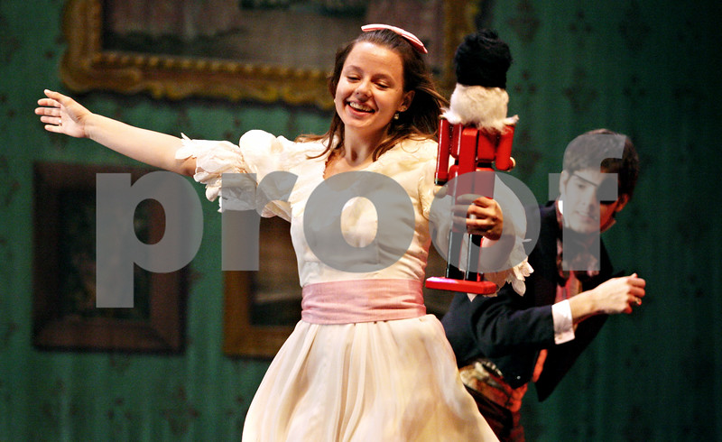 """Rob Winner – rwinner@daily-chronicle.com<br /> <br /> The Northern Illinois University School of Theatre and Dance students are putting on """"The Nutcracker"""" at the Egyptian Theatre this week. At the Egyptian Theatre in DeKalb, Dominica Sorenson dances around stage after receiving a nutcracker from fellow NIU student Kyle Rorie during rehearsal on Monday night."""