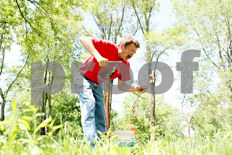 Rob Winner – rwinner@daily-chronicle.com<br /> <br /> Chris Gherity plants an oak tree on his property on Tuesday June 1, 2010 in Kingston, Ill. Gherity is a contractor with the Department of Natural Resources, growing trees for the DNR on his property.