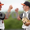 Rob Winner – rwinner@daily-chronicle.com<br /> <br /> Dekalb coach Justin Keck fist bumps pitcher Jake Lemay at the end of the fourth inning during the IHSA Class 3A DeKalb Sectional championship on Saturday June 5, 2010 in Dekalb, Ill. DeKalb went on to defeat Marmion Academy, 6-5.