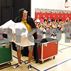 Rob Winner – rwinner@daily-chronicle.com<br /> <br /> Behind a stage curtain, Carlton Hall of FoodPlay changes into a costume during a performance at Southeast Elementary School in Sycamore, Ill. on Wednesday April 7, 2010. FoodPlay is an Emmy-award winning theater show intended to turn kids on to healthy eating and exercise habits.