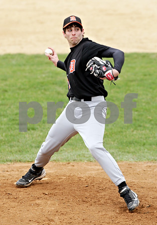 Beck Diefenbach  -  bdiefenbach@daily-chronicle.com<br /> <br /> DeKalb pitcher Mike Meier (21) throws the ball during the first inning of the game against Sycamore at Sycamore Park in Sycamore, Ill., on Thursday April 8, 2010.