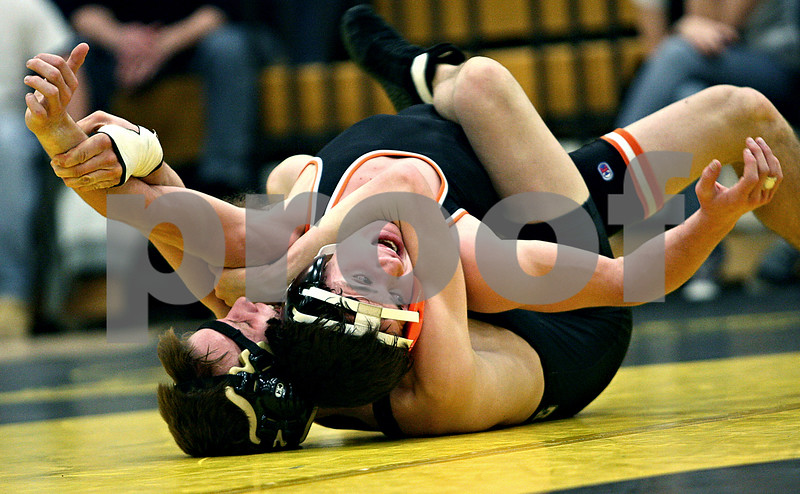 Rob Winner – rwinner@daily-chronicle.com<br /> Sycamore's Jeff Flanigan (bottom) tries to control DeKalb's Jake Jones during their 125-pound match in Sycamore, Ill. on Friday January 15, 2010. However Jones was able to win the match over Flanigan.