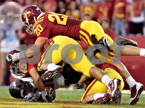 Beck Diefenbach  -  bdiefenbach@daily-chronicle.com<br /> <br /> Northern Illinois running back Chad Spann (28) is tackled by Iowa State linebackers Matt Tau'fo'ou (45, center) and Jake Knott (20) during the first quarter of the game at Jack Trice Stadium on the campus of Iowa State University in Ames, Iowa, on Thursday Sept. 2, 2010. Iowa State defeated Northern Illinois 27 to 10.