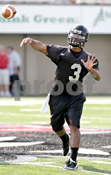 Beck Diefenbach - bdiefenbach@daily-chronicle.com<br /> <br /> Northern Illinois quarterback DeMarcus Grady during the first practice at Huskie Stadium in DeKalb, Ill., on Thursday Aug. 5, 2010.
