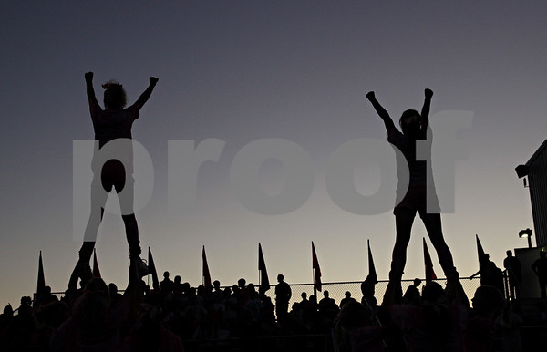 Beck Diefenbach  -  bdiefenbach@daily-chronicle.com<br /> <br /> Genoa-Kington cheerleaders perform during an unexpected break in play when the main field lights turned off after the first quarter of the game agianst Aurora Central Catholic at Genoa-Kingston High school in Genoa, Ill., on Friday Aug. 27, 2010.