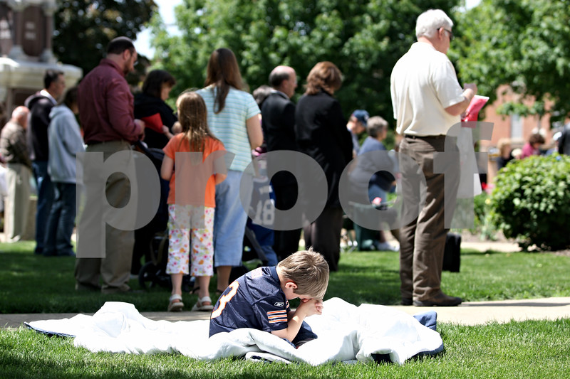 Rob Winner – rwinner@daily-chronicle.com<br /> <br /> David Sutter, 6, of DeKalb, prays by himself on a blanket during the National Day of Prayer outside the DeKalb County Court House in Sycamore, Ill. on Thursday May 6, 2010.