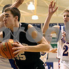 Rob Winner – rwinner@daily-chronicle.com<br /> On Saturday January 16, 2010 in Hinckley, Ill., Dave Dudzinski controls a rebound under the Kaneland basket and then puts up two during the first quarter against Hinckley-Big Rock.