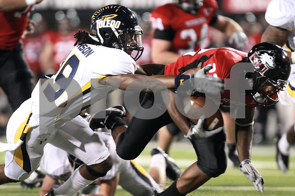 Kyle Bursaw - kbursaw@daily-chronicle.com<br /> <br /> Toledo safety Jermaine Robinson (29) reaches for Northern Illinois running back Ricky Crider (22) during the first quarter in DeKalb, Ill. on Nov. 9, 2010