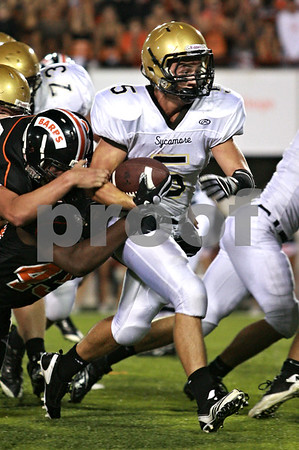 Beck Diefenbach – bdiefenbach@daily-chronicle.com<br /> <br /> Sycamore running back Eric Ray (5) rushes with the ball during the second quarter of the Castle Challenge football game between DeKalb and Sycamore High Schools at Huskie Stadium on the campus of Northern Illinois University in DeKalb, Ill., on Friday Sept. 10 2010.