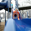 Rob Winner – rwinner@daily-chronicle.com<br /> <br /> Savanna Strub, 7 of Malta, goes down one of the many slides on the playground at Hopkins Park in DeKalb, Ill. on Wednesday March 24, 2010.