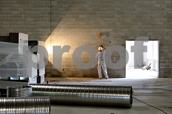 Rob Winner – rwinner@daily-chronicle.com<br /> <br /> Stanislaw Pakos smoothes an interior wall of the field house at the new DeKalb High School in DeKalb, Ill. on Wednesday June 9, 2010.