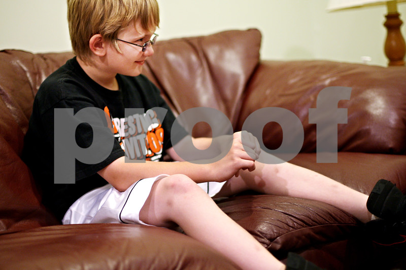 Beck Diefenbach  -  bdiefenbach@daily-chronicle.com<br /> <br /> Andrew Parker, 10, talks with a therapist during a family counseling session at the Youth Services Bureau in DeKalb, Ill., on Monday June 28, 2010.