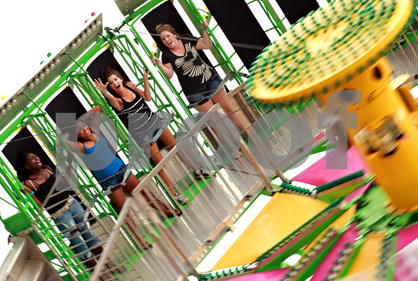 Beck Diefenbach - bdiefenbach@daily-chronicle.com<br /> <br /> Appearing to defy gravity, (from left to right) Janelle Hammack, Abby Bonifacio, Shyanne Smith and Jill Smith, all 16 of DeKalb, ride Zero Gravity at Cornfest at the DeKalb Municipal Airport in DeKalb, Ill., on Friday Aug. 20, 2010.
