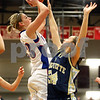 Rob Winner – rwinner@daily-chronicle.com<br /> Hinckley-Big Rock's Tess Godhardt (left) puts up a shot for two over Ottawa Marquette's Katelyn McDonald during the first quarter of their Class 1A sectional game in Mooseheart, Ill. on Tuesday February 16, 2010.
