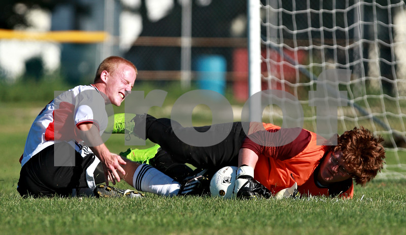 Beck Diefenbach  -  bdiefenbach@daily-chronicle.com<br /> <br /> Indian Creek Ryan Gullstrand's (5, left) crashes into Paw Paw goal keeper Mitch Prentice during the first half of the game at Waterman middle School in Waterman, Ill., on Thursday Aug. 26, 2010. Indian Creek defeated Paw Paw 6 to 2.