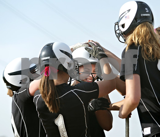 Beck Diefenbach  -  bdiefenbach@daily-chronicle.com<br /> <br /> Kaneland's Rilee Vest (29, center) is congratulated by teammates following her three-run home run during the first inning of the game against Sycamore at Sycamore High School in Sycamore, Ill., on Tuesday April 20, 2010. Kaneland defeated Sycamore 10 to 0 in six innings.